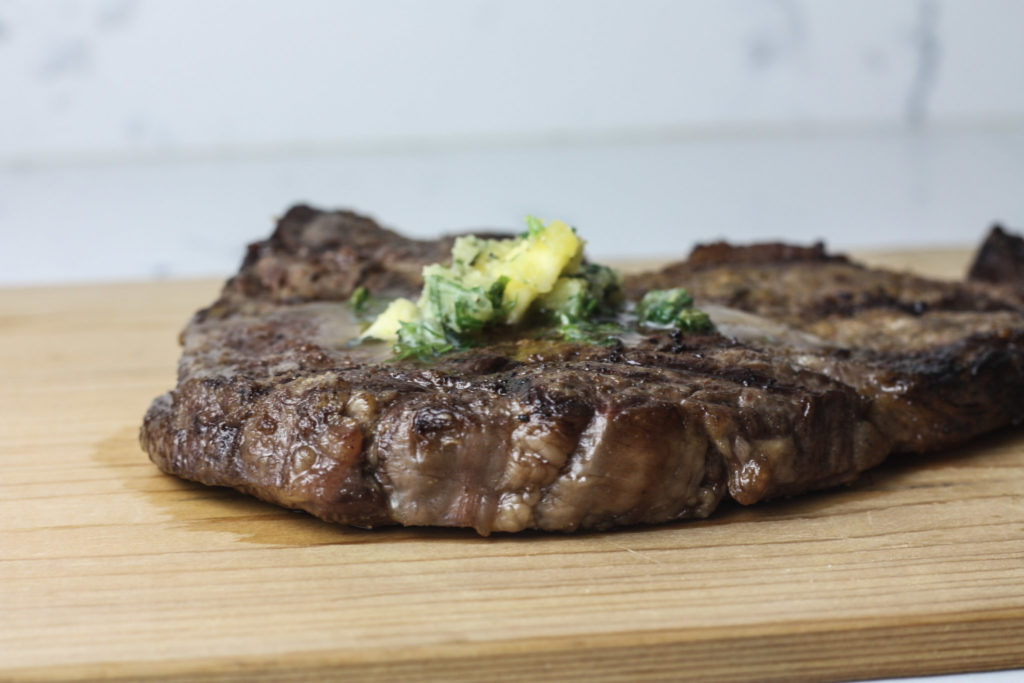Grilled Ribeye with Garlic and Herb Compound Butter