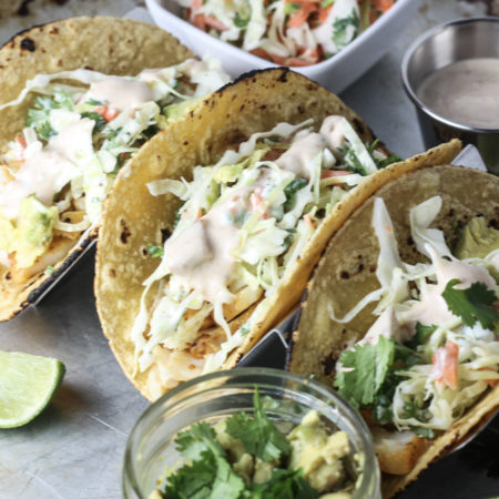 Fish Tacos with Cabbage Jalapeño Slaw and Chipotle White Sauce | A quick, easy and healthy fish taco recipe that comes together in under 20 minutes! | mincerepublic.com