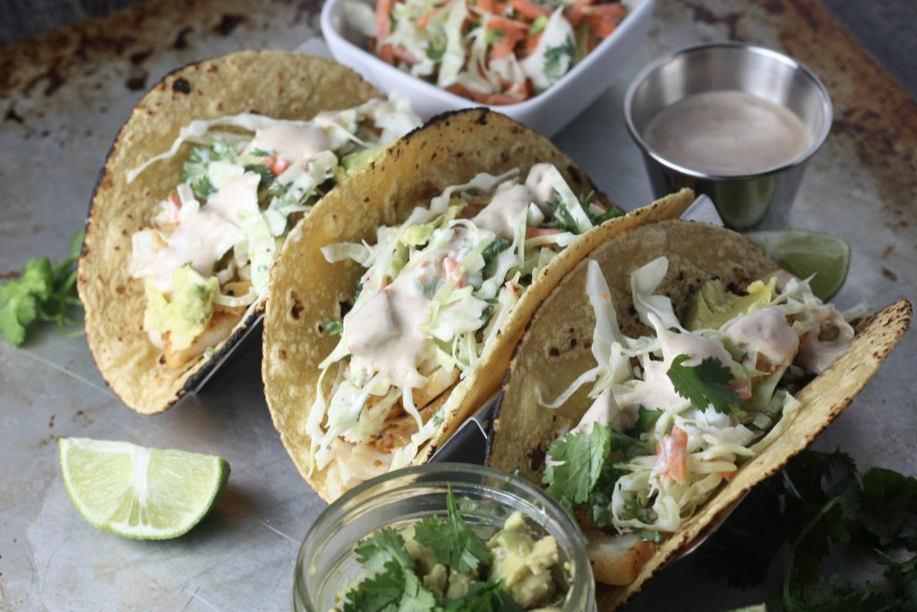 Fish Tacos with Cabbage Jalapeño Slaw and Chipotle White Sauce   A quick, easy and healthy fish taco recipe that comes together in under 20 minutes!   mincerepublic.com