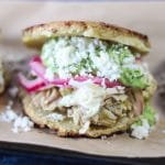 Arepas with Chile Verde Chicken & Guasacaca (Avocado Salsa) | A #lowcarb & #keto version of Arepas filled with Chile verde chicken, Avocado Sauce and slaw. | mincerepublic.com