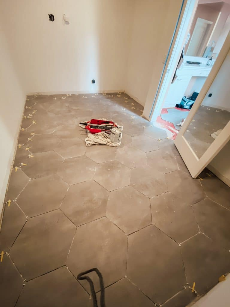 freshly laid gray tile in closet
