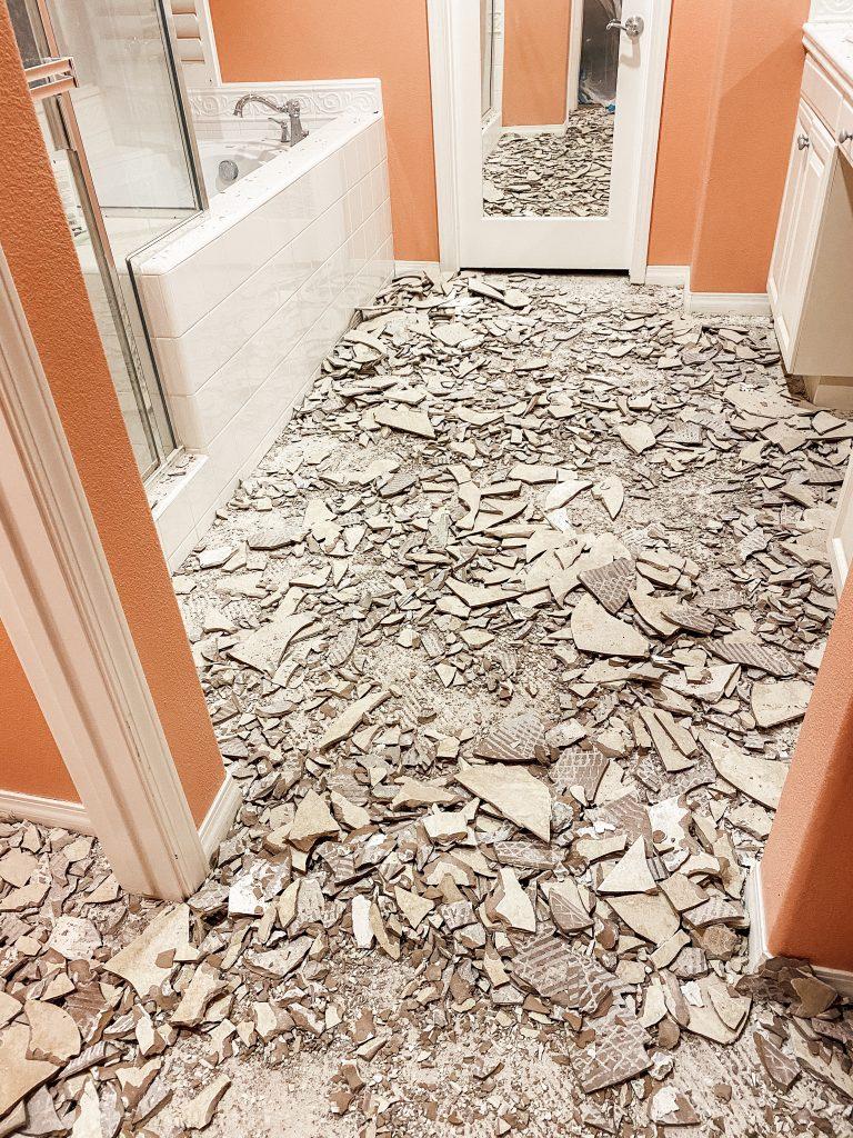 demo'ed tile all over the bathroom floor