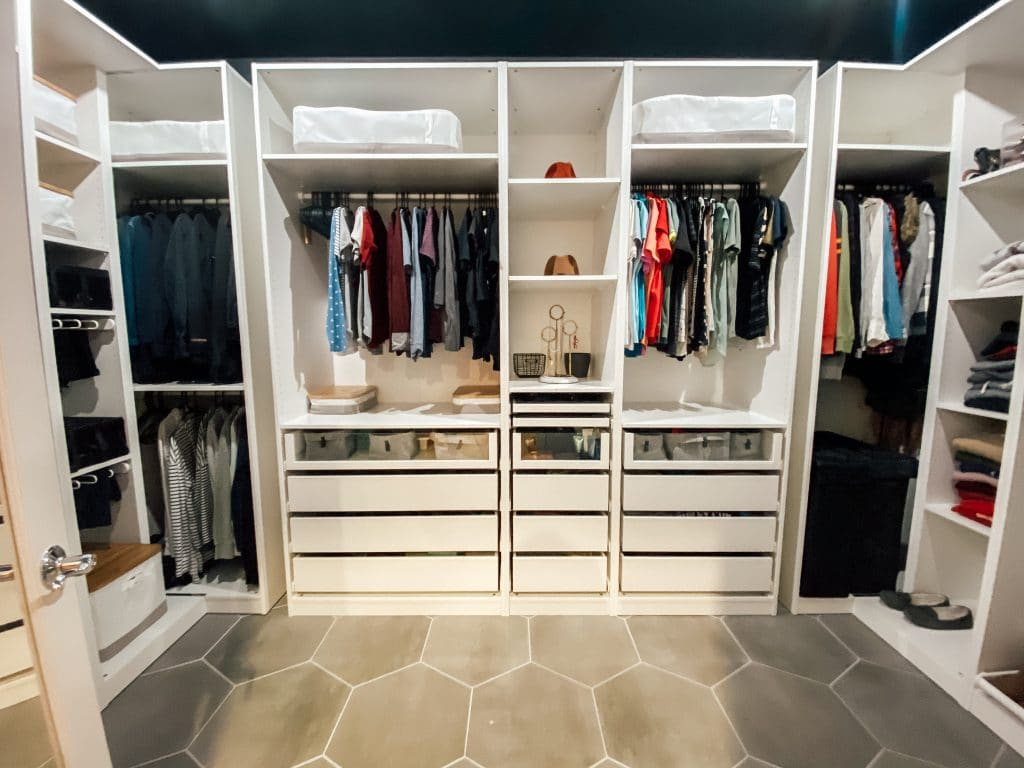 new closet with big built ins, drawers and closet rods