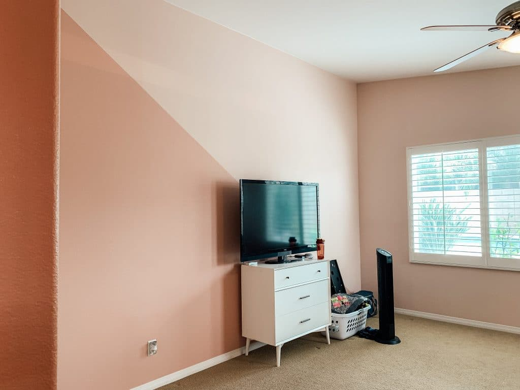 tv on nightstand in pink bedroom with open window