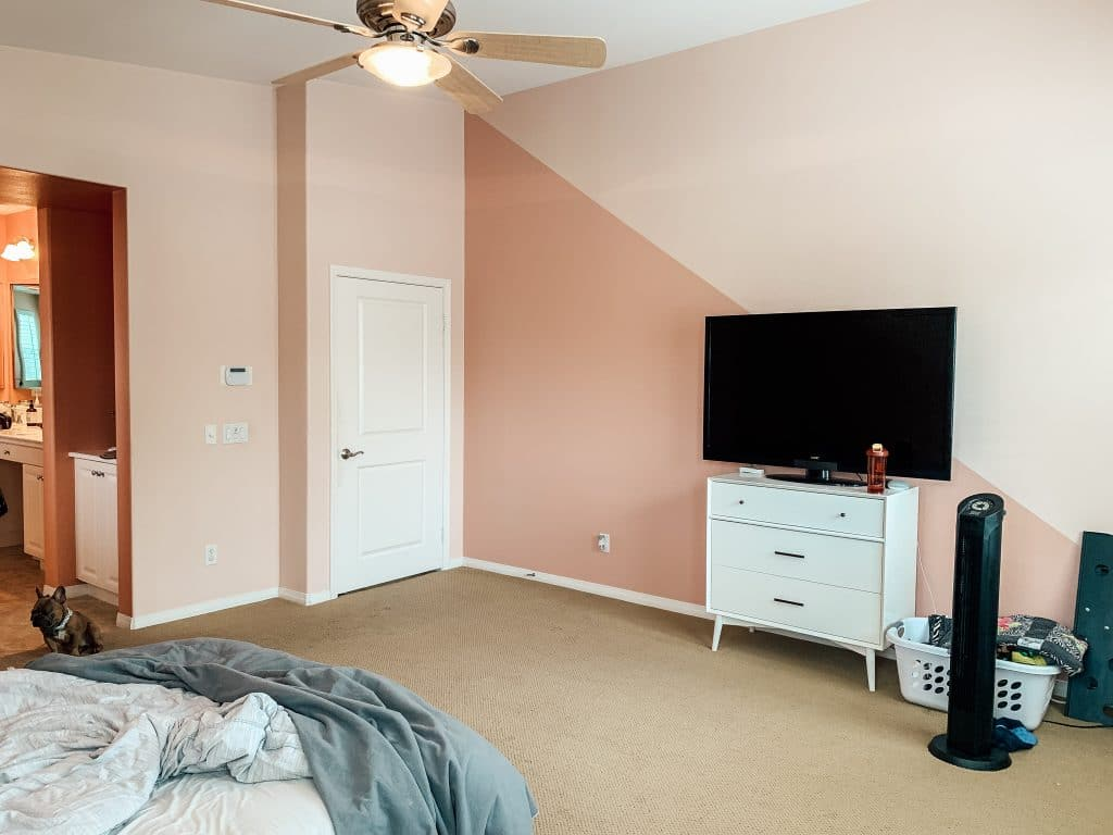 pink bedroom with TV on nightstand and ceiling fan on ceiling