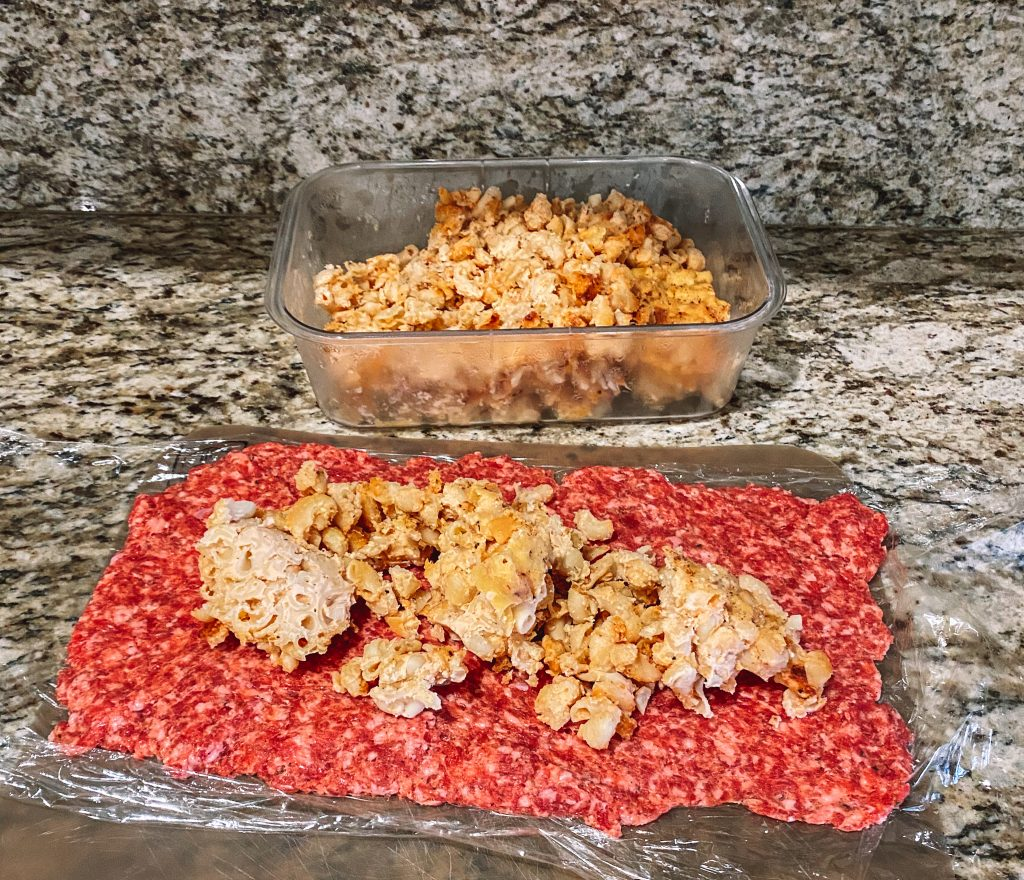 wrapped macaroni and cheese in sausage to make a fatty