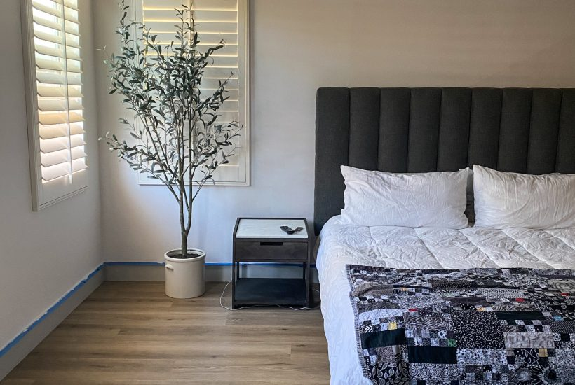 owners suite white wall with headboard and potential accent wall