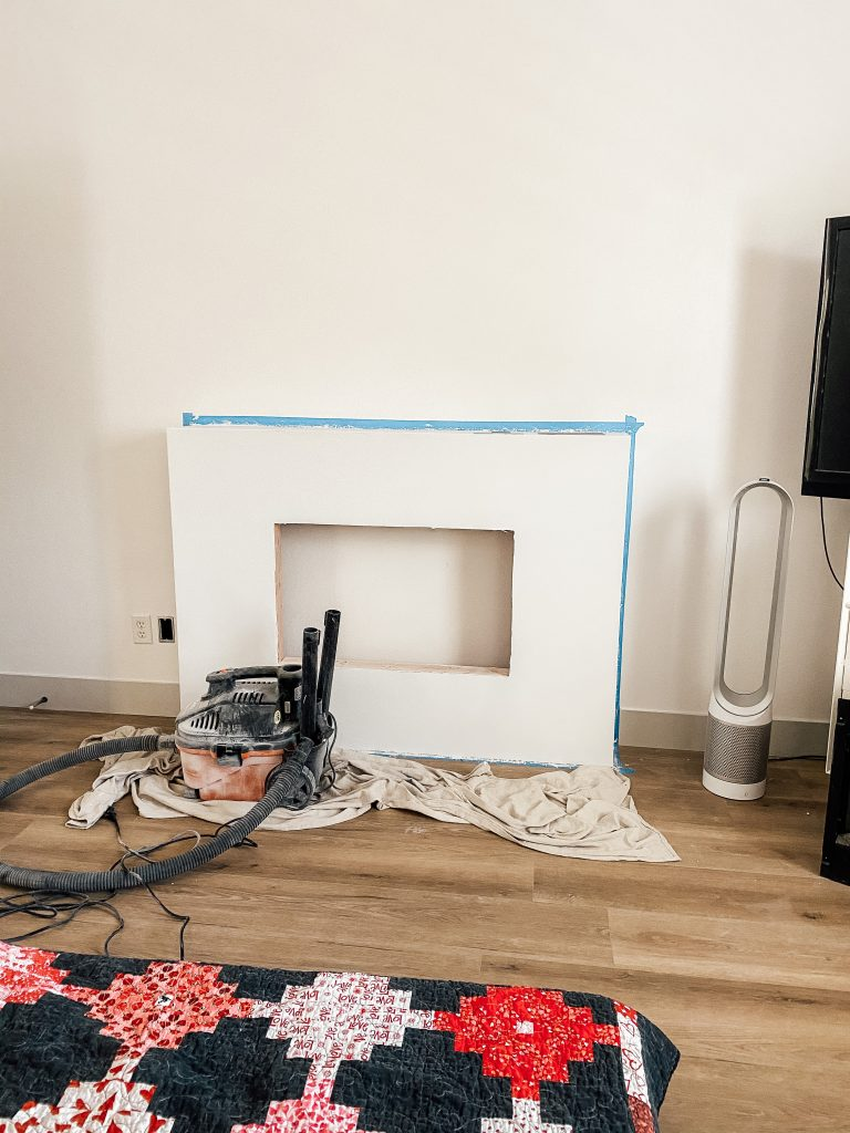 building an electric fireplace for owners suite makeover