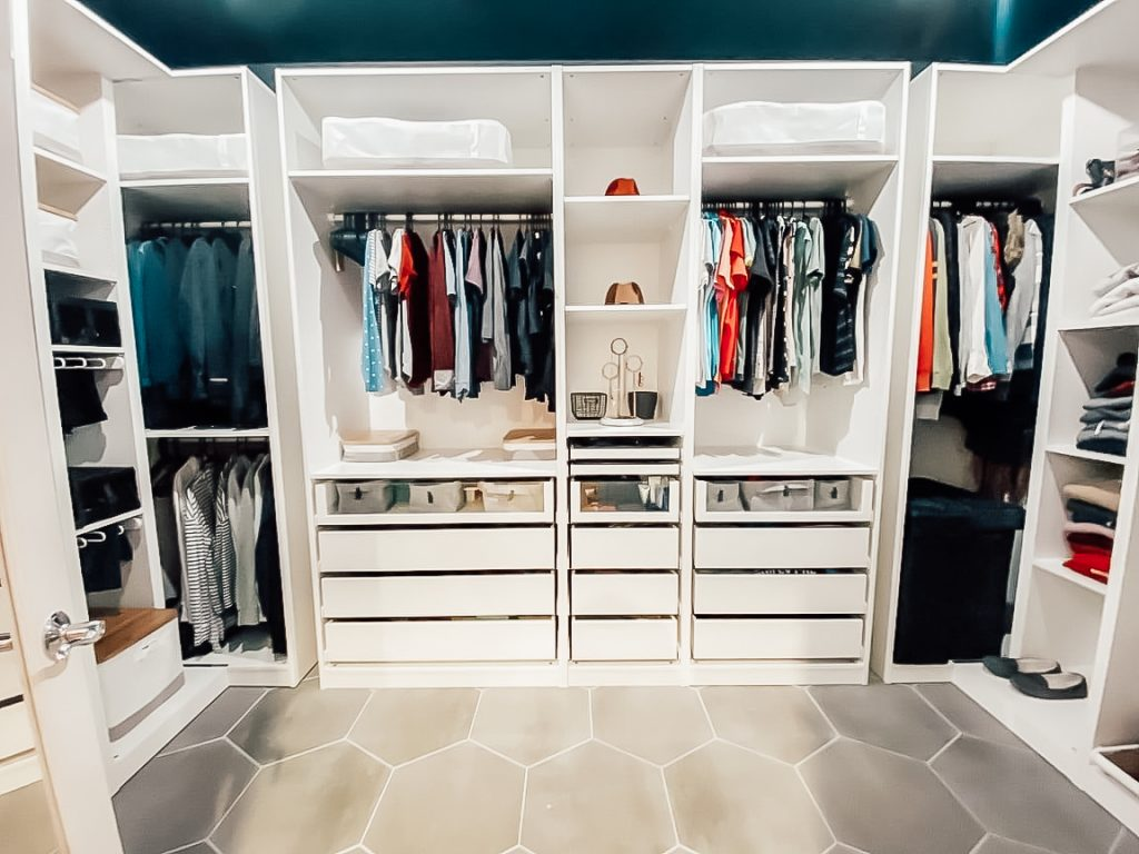 closet with white built ins and hanging clothes