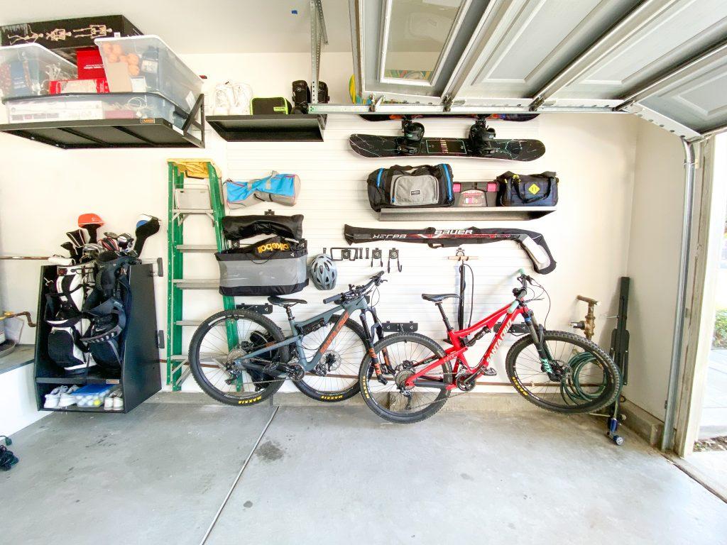 garage gear wall with bikes, hockey sticks, snowboards