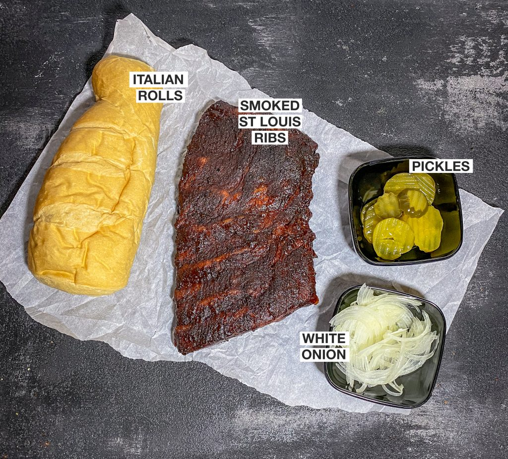 Italian rolls, smoked st Louis ribs, pickles and white onion on a platter