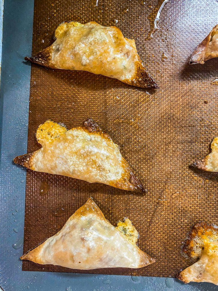 wontons on a baking sheet